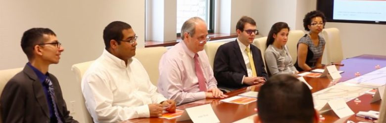 Four USBLN's mentees traveled to New York City to learn from and network with corporate partner, Voya Financial. This picture shows the mentees and the Director for the Rising Leaders Initiatives sitting in on a meeting with Voya's Chairman and CEO, Rod Martin.