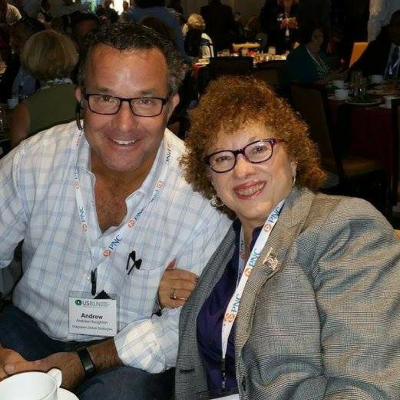 Photo of Joyce Bender and Andrew Houghton smiling together at a conference